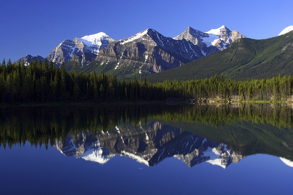 Reflection of mountains in water, Lake Herbert, Wenkchemna Peaks, Banff National Park, Alberta, Canada : Stock Photo