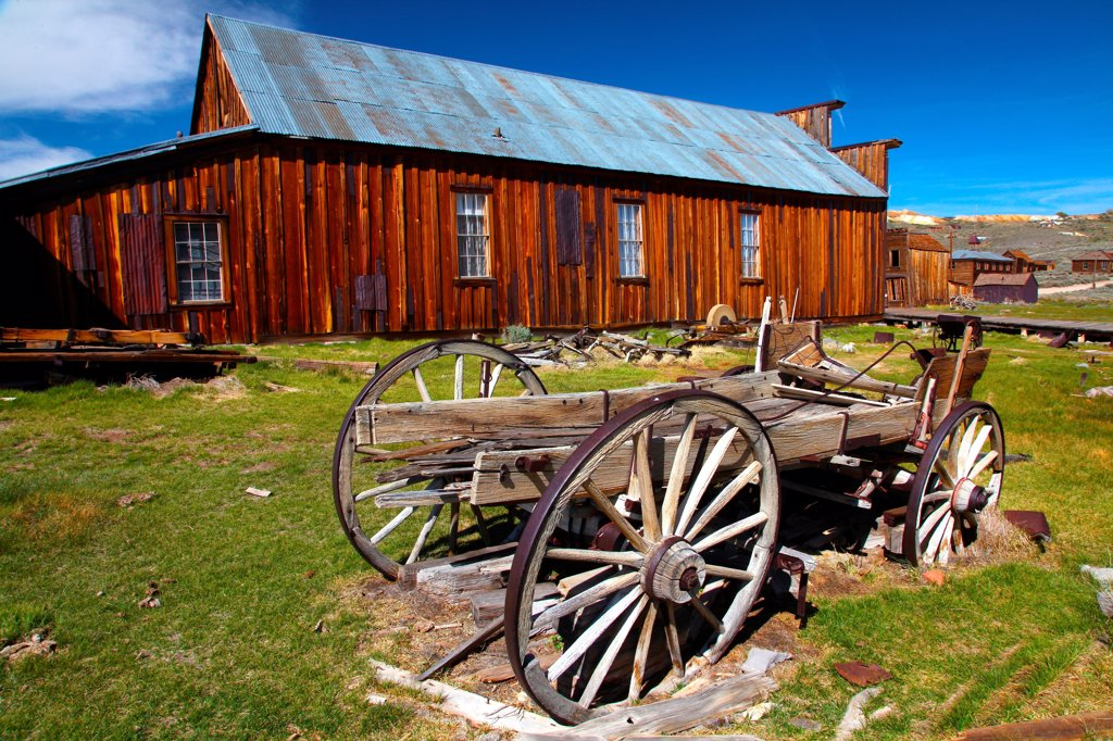 Stock Photo: 2005-595103 USA, California, Sierra Nevada, Bodie Ghost Town State Historical Park, Miners' Union Hall and old Wagon
