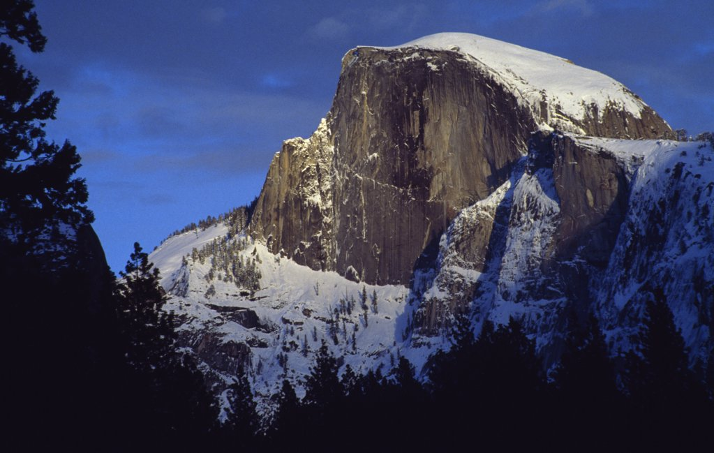 Low angle view of a snow covered mountain, Half Dome, Yosemite National Park, California, USA : Stock Photo