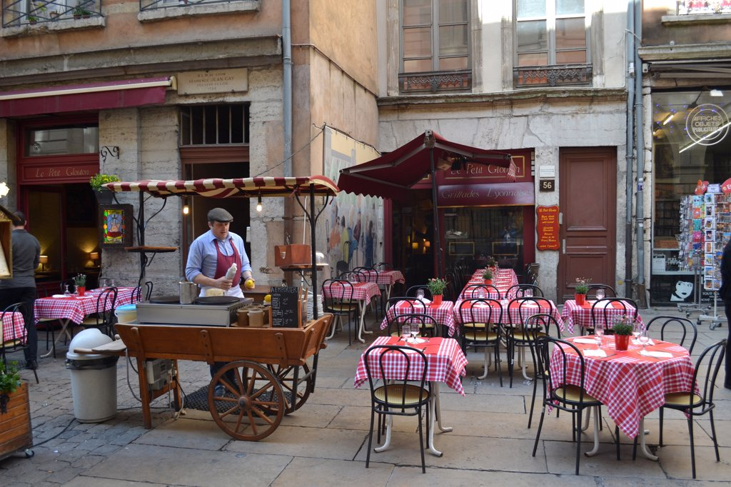 Empty tables and chairs at a sidewalk cafe, Lyon, Rhone-Alpes, France : Stock Photo