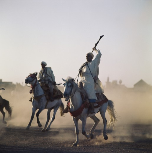 Stock Photo: 2029-424421 Men riding horses, Berbers, Marrakesh, Morocco