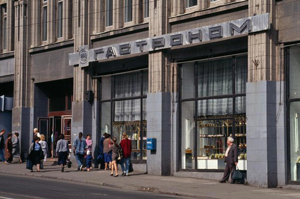 Stock Photo: 2032-1060 Russia, Vladivostok, Pedestrian walking in front of shop