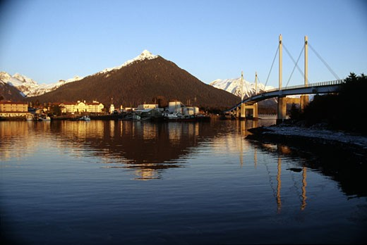 Stock Photo: 2032-1751 USA, Alaska, Sitka, Bridge with snowcapped mountains