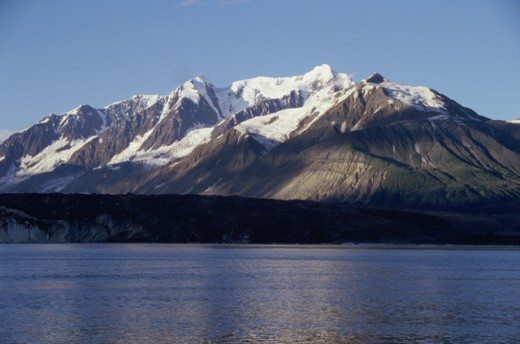 Lake in front of snowcapped mountains, Russell Fjord, Alaska, USA : Stock Photo