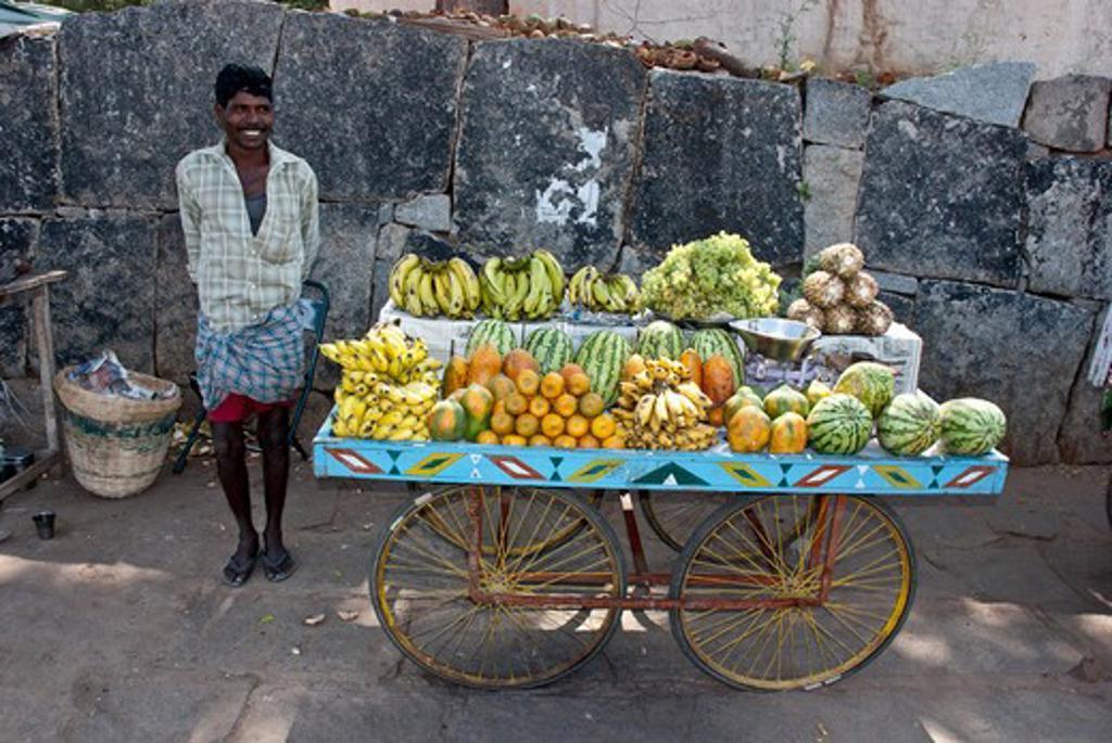 Fruit seller on a street with fruit cart, Hampi, Karnataka, India : Stock Photo