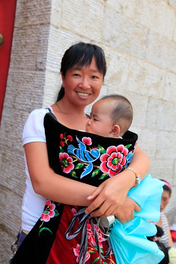 Stock Photo: 2032R-600427 China, Kunming, Portrait of mother with baby son