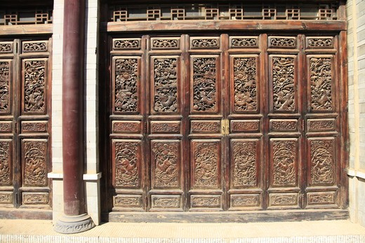 China, Kunming, Wooden wall with reliefs : Stock Photo