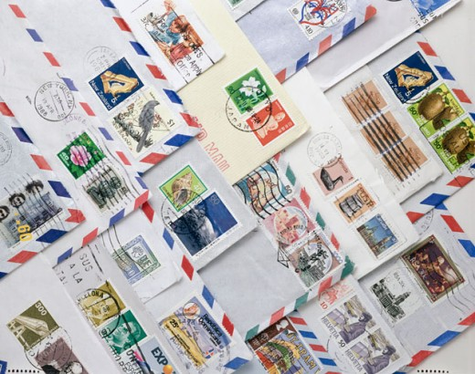 Close-up of postage stamps on envelopes : Stock Photo