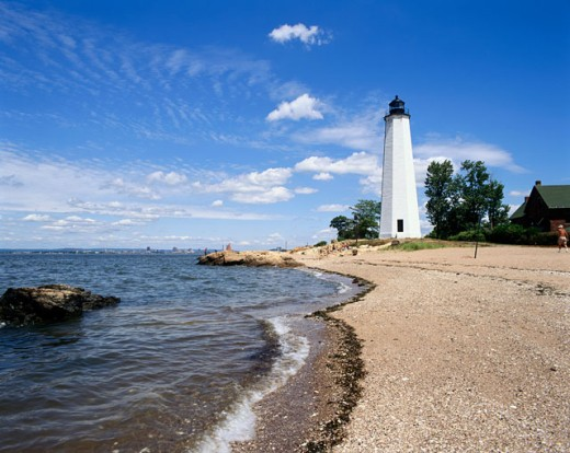 Lighthouse on the beach, Five Mile Point Lighthouse, New Haven, Connecticut, USA : Stock Photo