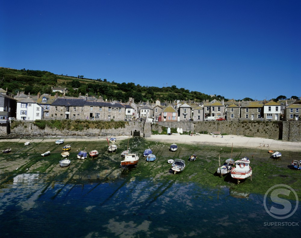 Boats docked at a port, Mousehole, Cornwall, England : Stock Photo