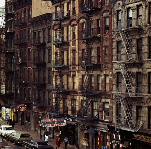 Group of people walking in front of apartments, New York City, New York, USA : Stock Photo