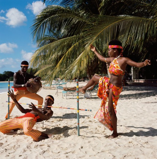 Three young men dancing on the beach, Limbo Dance, Barbados : Stock Photo