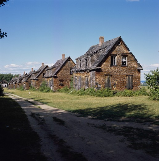 Wooden buildings in a row, Val-Jalbert Ghost Town, Quebec, Canada : Stock Photo