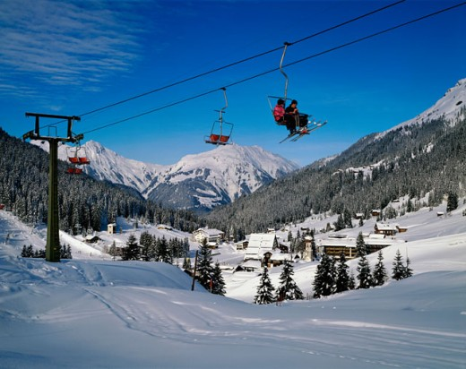 Stock Photo: 2058-549105 Low angle view of people on a ski lift, Montafon, Vorlarlberg, Austria