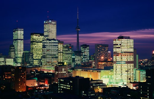 Skyscrapers lit up at night, Eaton Centre and CN Tower, Toronto, Ontario, Canada : Stock Photo