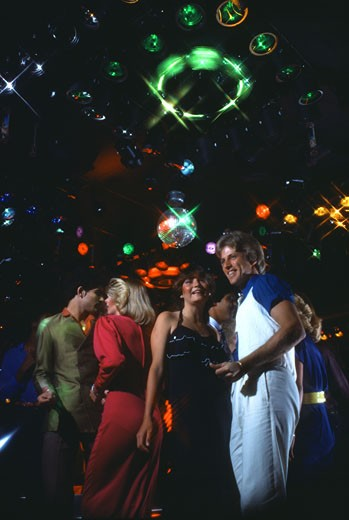 Stock Photo: 208-213 Group of people dancing in a nightclub
