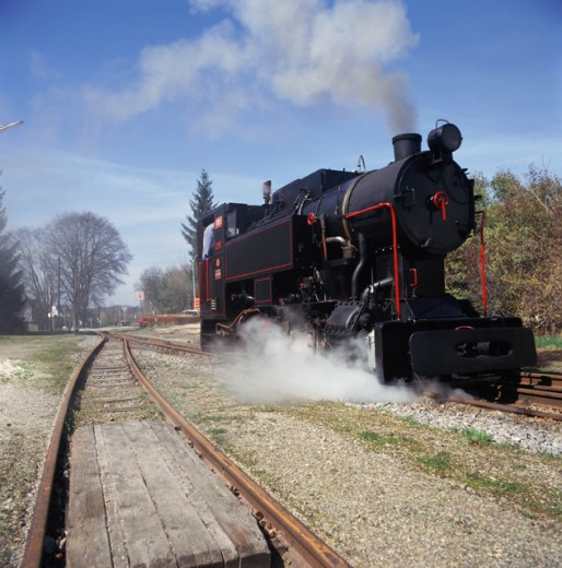 Stock Photo: 2102-3146 Steam engine moving on railroad tracks, Austria