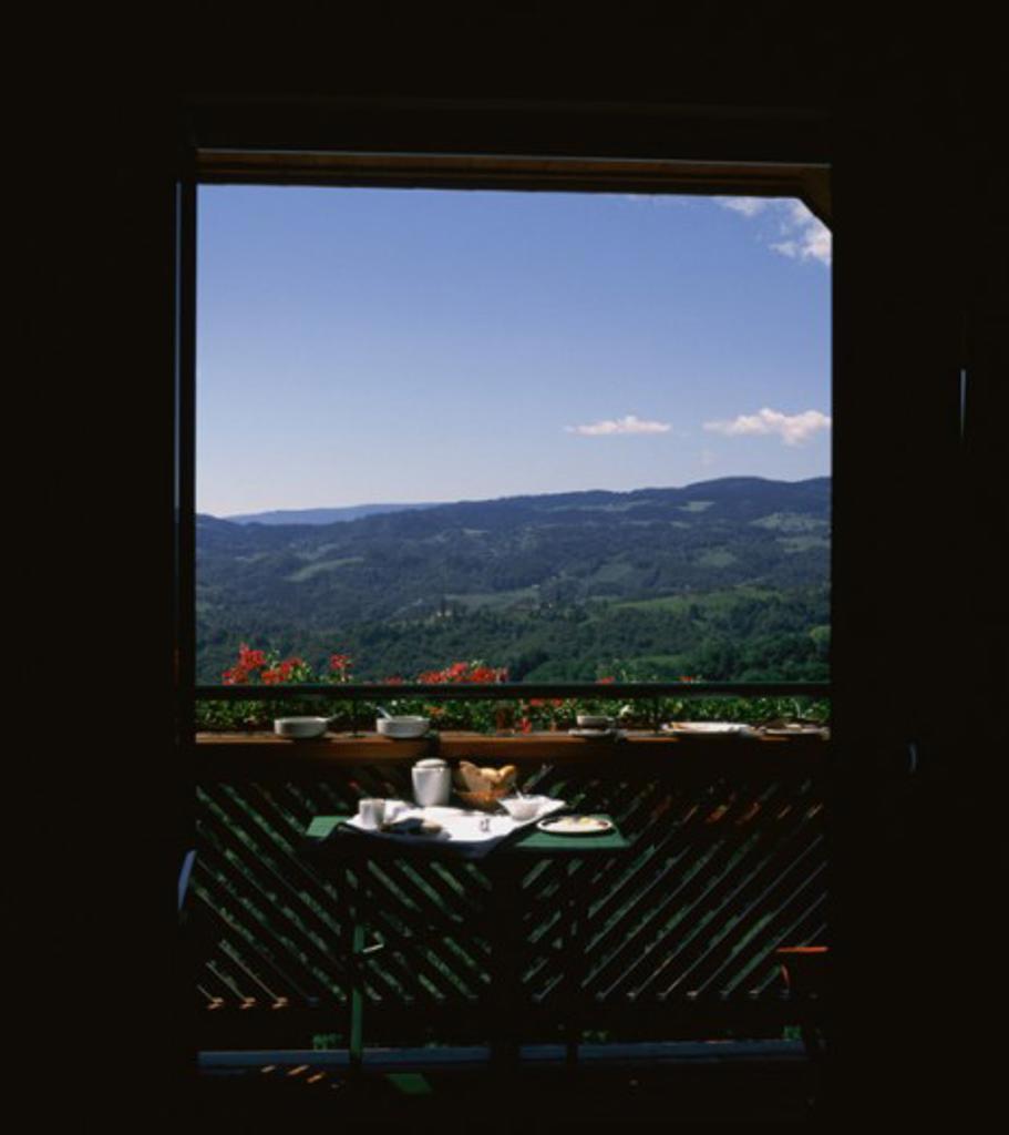 Panoramic view of mountains seen through a door, Buschenschank, Austria : Stock Photo