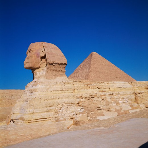 Statue of sphinx in front of a pyramid, Great Sphinx, Pyramid Of Chephren, Giza, Egypt : Stock Photo