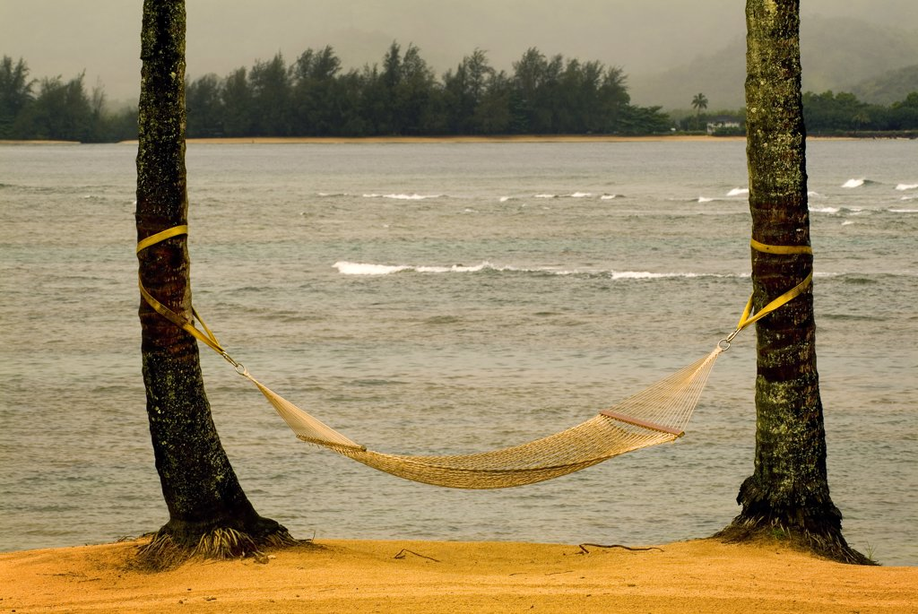 Stock Photo: 2117-477 Hammock tied between two trees on the beach, Hanalei, Kauai, Hawaii, USA