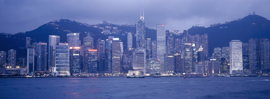 Stock Photo: 2117-481 Skyscrapers lit up at night, Victoria Harbor, Hong Kong, China
