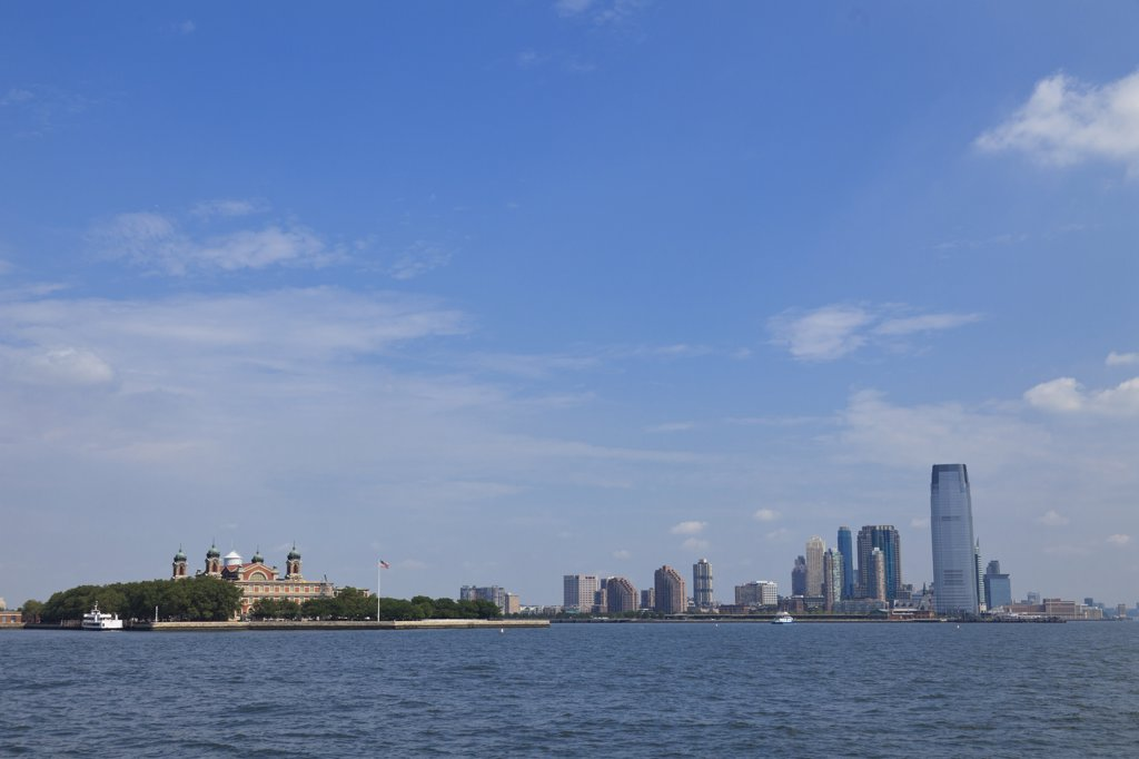 USA, New York Harbor, Ellis Island on left and Jersery City on right : Stock Photo