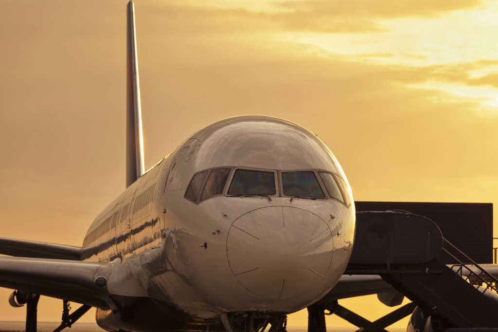 USA, Hawaii, Keahole, Kona International Airport, Close up of Boeing 737 at sunset : Stock Photo