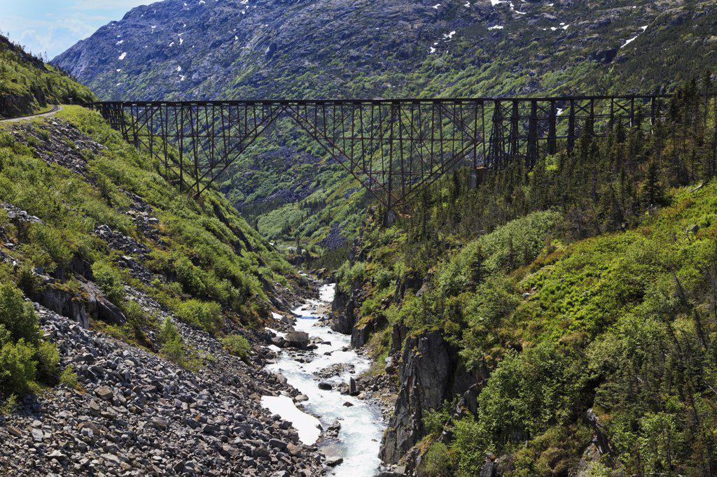USA, Alaska, Original steel trestle bridge on Dead Horse Gulch : Stock Photo