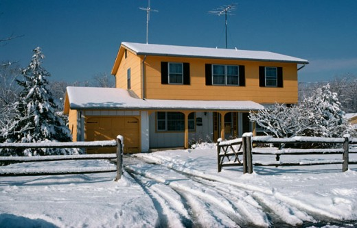Stock Photo: 2123-558334 Tire tracks in snow in front of a colonial house, Jackson Township, New Jersey, USA
