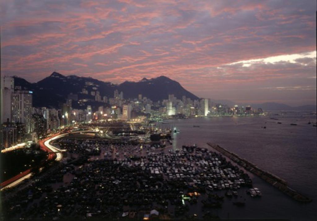 Aerial view of a city lit up at night, Hong Kong, China : Stock Photo