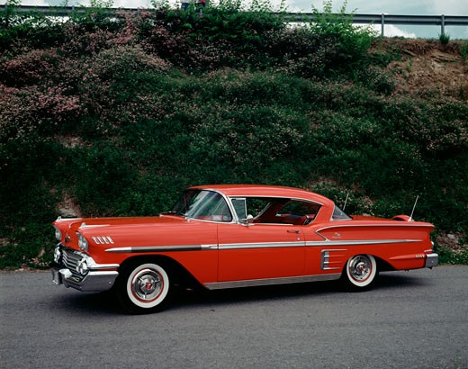 Vintage car on the road, Chevrolet Impala : Stock Photo