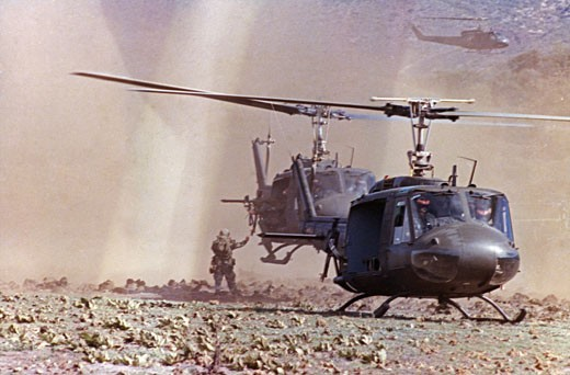 UH-1A Iroquois Helicopters Arrive at a Landing Zone with Soldiers Conducting an Air-Mobile Assault : Stock Photo
