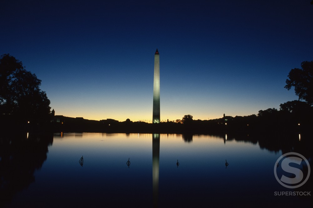 Reflection of an obelisk on water, Washington Monument, Washington DC, USA : Stock Photo