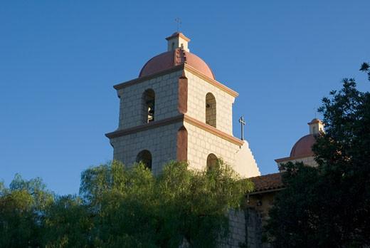 Low angle view of trees in front of a church, Mission Santa Barbara, Santa Barbara, California, USA : Stock Photo