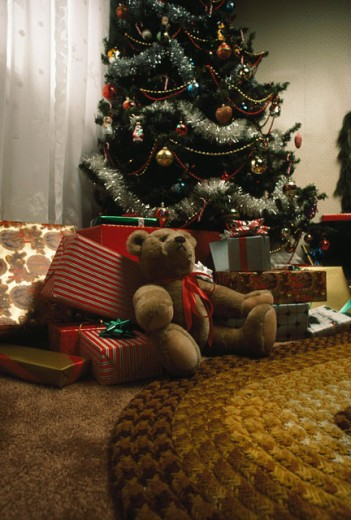 Stock Photo: 230-1138 Christmas presents under a Christmas tree