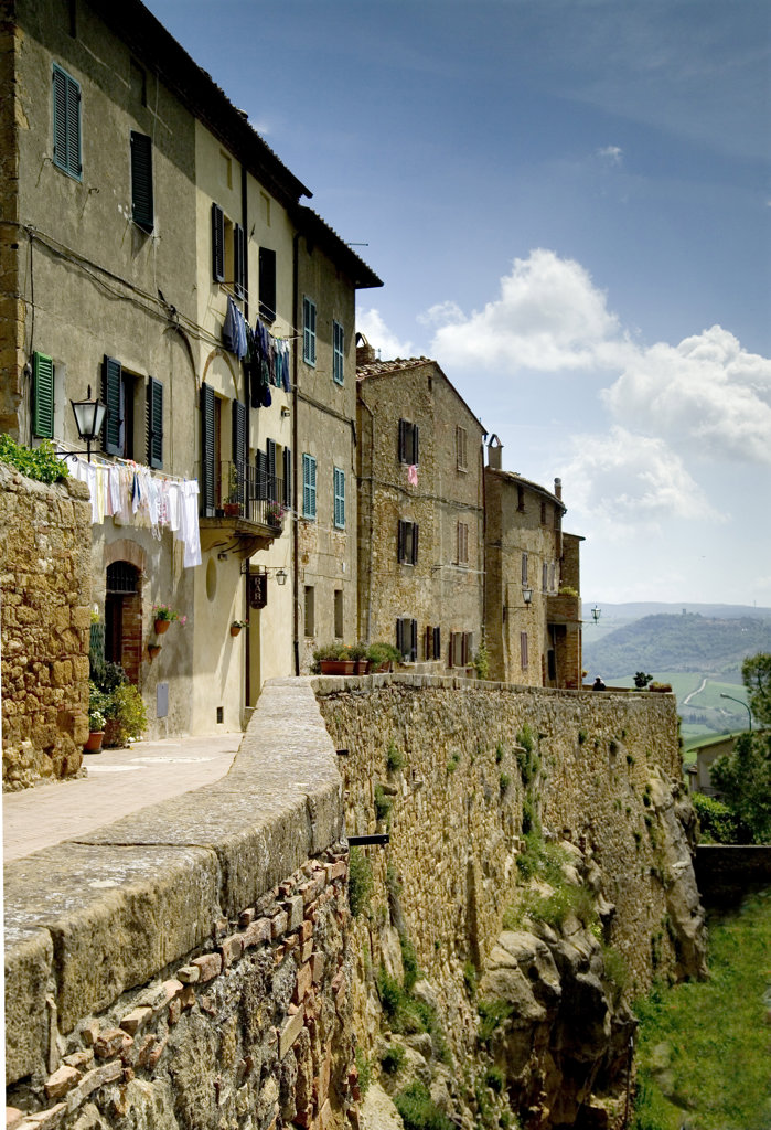 Walkway along buildings, Pienza, Italy : Stock Photo