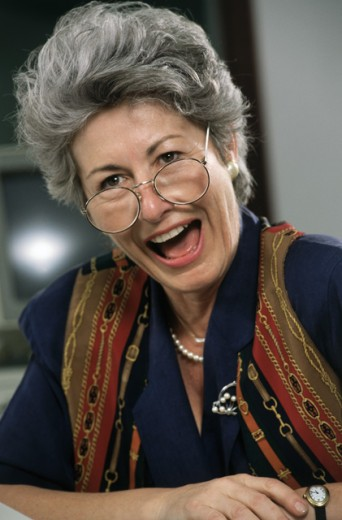 Close-up of a businesswoman laughing : Stock Photo