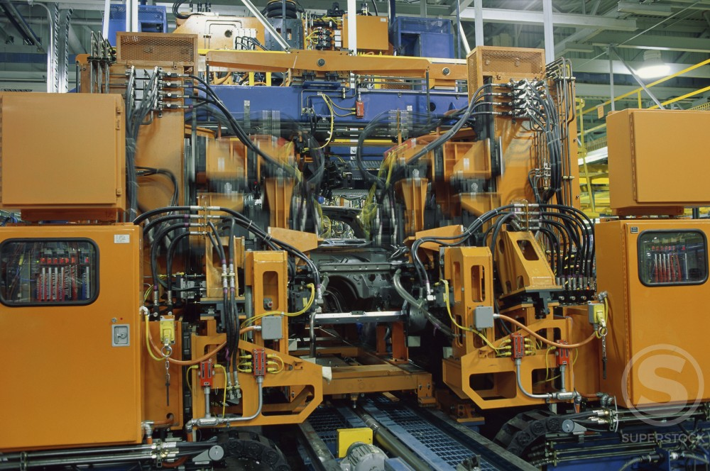 Cars on a production line being assembled by robotic arms : Stock Photo
