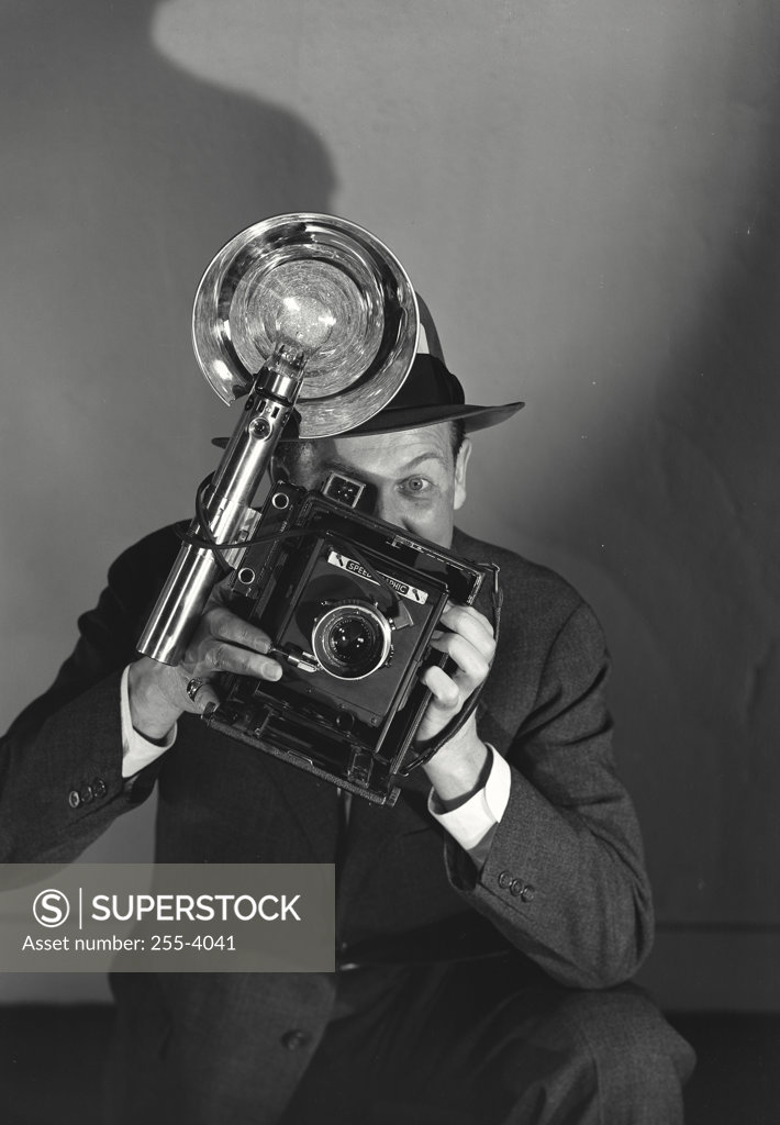 Stock Photo: 255-4041 Portrait of a photographer holding a camera
