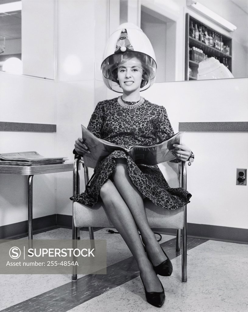 Stock Photo: 255-4854A Portrait of a young woman sitting in an armchair under a hair dryer, 1964