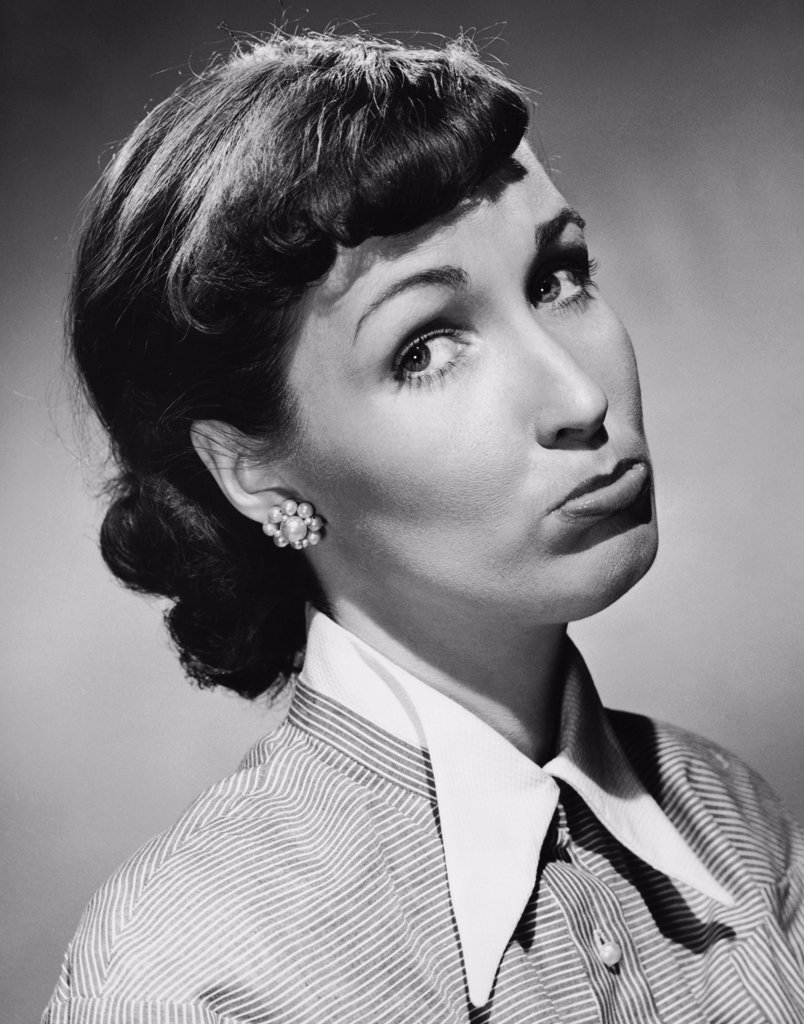 Close-up of a young woman making a face : Stock Photo