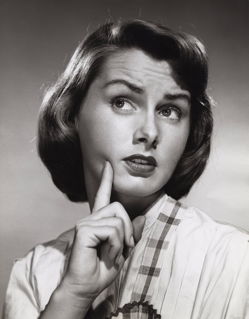 Stock Photo: 255-10733 Close-up of a young woman with her finger on her face