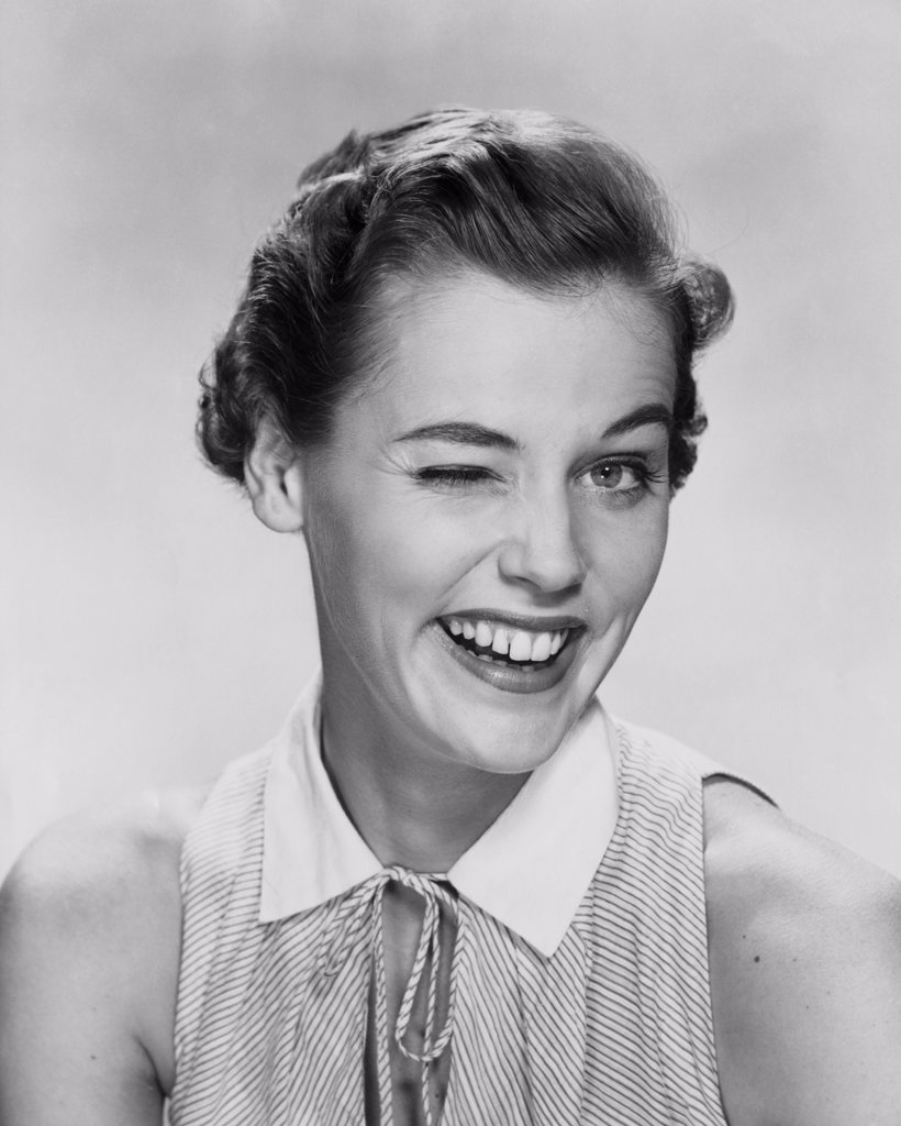 Stock Photo: 255-10913 Portrait of a young woman winking