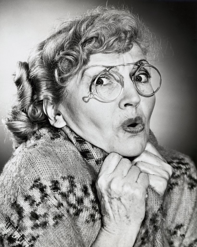 Stock Photo: 255-11663 Portrait of a senior woman looking scared