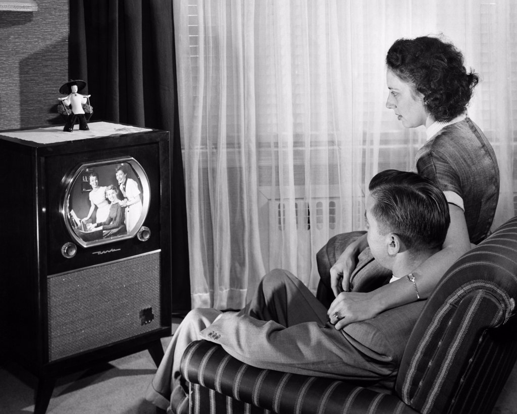 Stock Photo: 255-1233 Mid adult couple watching television