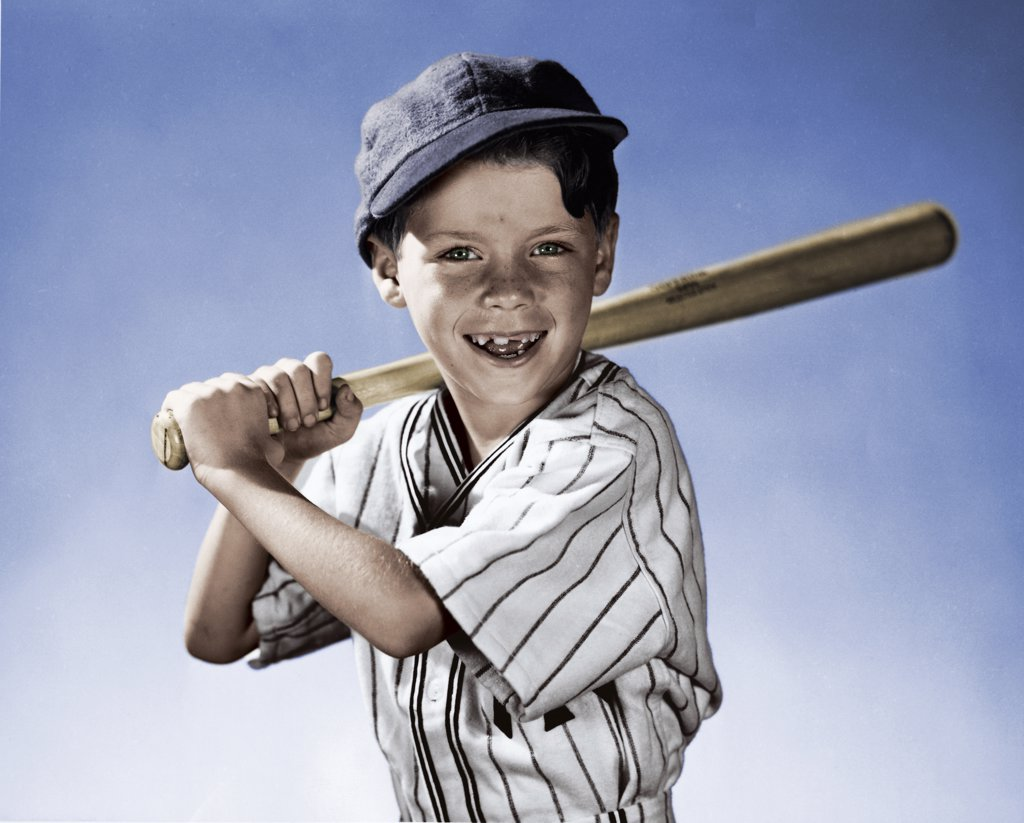 Stock Photo: 255-12905A Portrait of boy swinging baseball bat