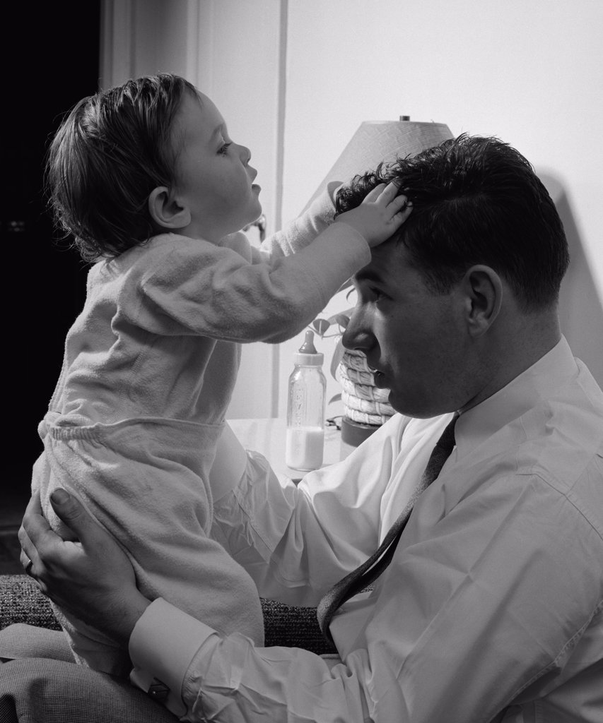 Stock Photo: 255-1391A Father holding son in home