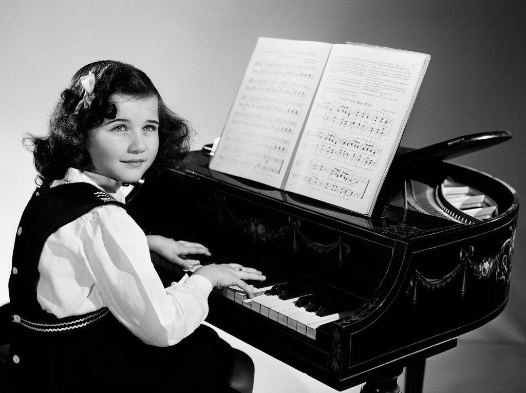 Stock Photo: 255-14252 Girl playing piano