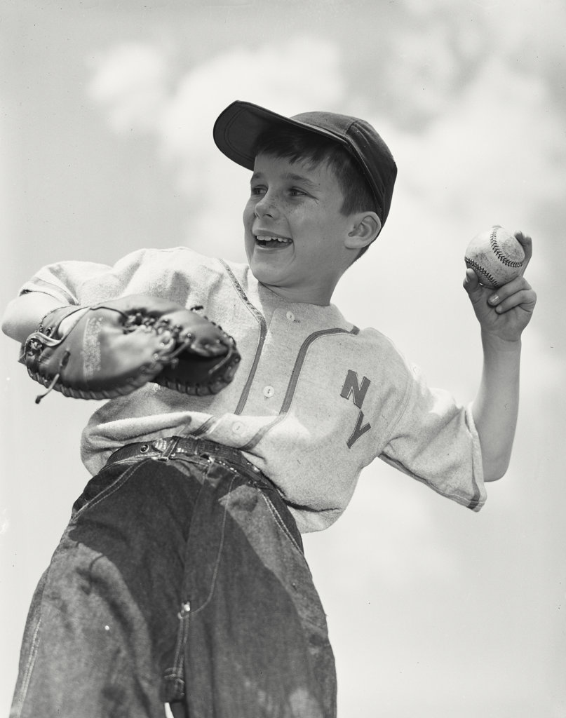 Boy pitching in baseball game : Stock Photo