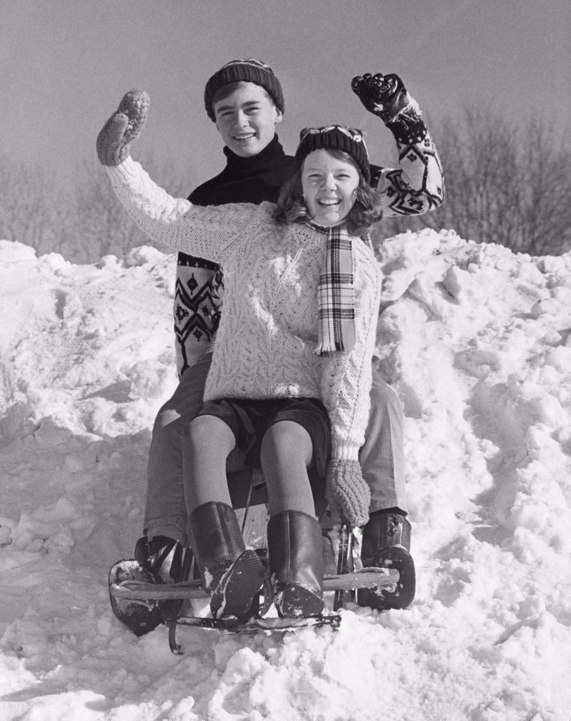 Stock Photo: 255-15409 Teenage couple on a sled